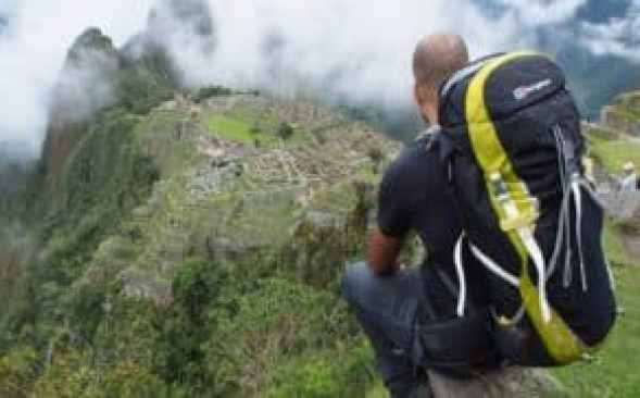 backpacker overseeing Machu Picchu - how to get from lima to machu picchu