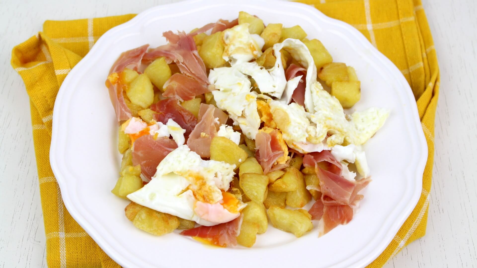 Huevos rotos con jamón versión ligera