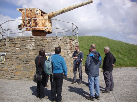 A guided walk around Lyness led by IoHDT Wartime Heritage Officer Gavin Lindsay