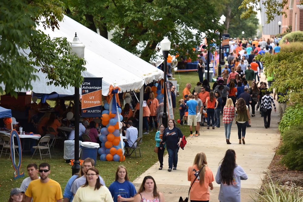 Aerial view of outdoor tents on the UTM Quad decorated with orange and blue balloons