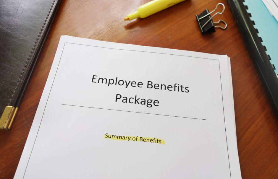 Employee Benefits Package document on an office desk