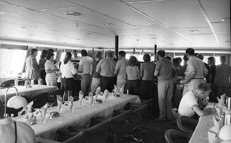 Dining at a standing table has long been a popular activity for boat travel.  Cruisers enjoyed a buffet in 1972.