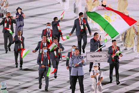 The Tajikistan Olympic team was seen at the opening mainly without masks.