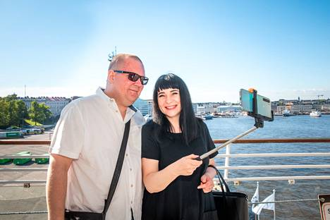 Timo Lindqvist and Irina Lotnikova take a selfie on the deck of the ship before departure.