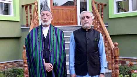 Hamid Karzai (left) and Abdullah Abdullah are said to have met with each other and Taliban representatives to create a new regime in Afghanistan.  Picture from Abdullah's Facebook page.