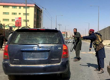 Taliban fighters inspected the car on Kabul Street on Monday, August 16th.
