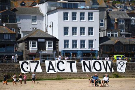 A poster demanding the environmental actions of the Elokapina movement was hung on the seafront at St Ives in Cornwall on Sunday.