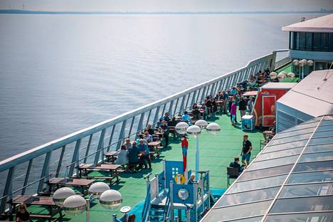 The sunny weather attracted passengers to the deck of the ship on Saturday.