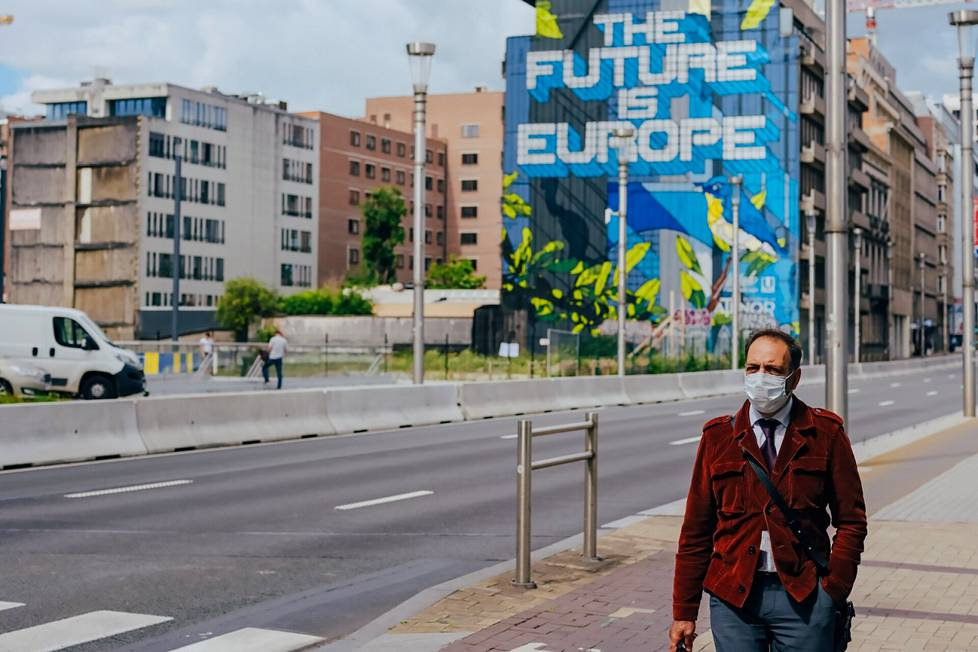 Even before the crown, European member states began to restrict the free movement of citizens.  The man was walking on a street in Brussels in the summer of 2020.