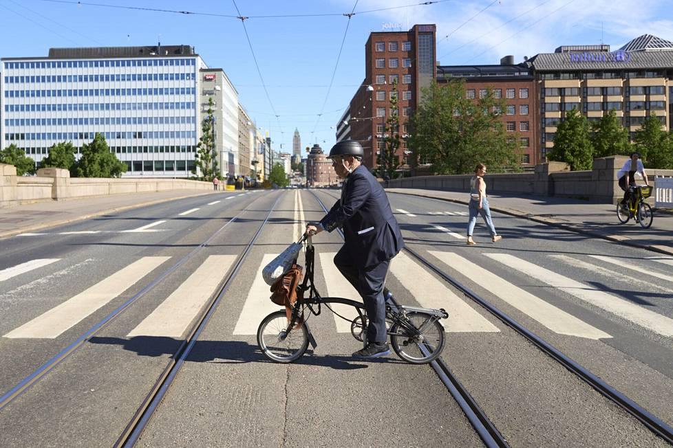 Juhana Vartiainen mainly travels on his folding bicycle.