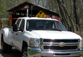 Photo by H.S. Cooper © Chevy at covered bridge (PA)