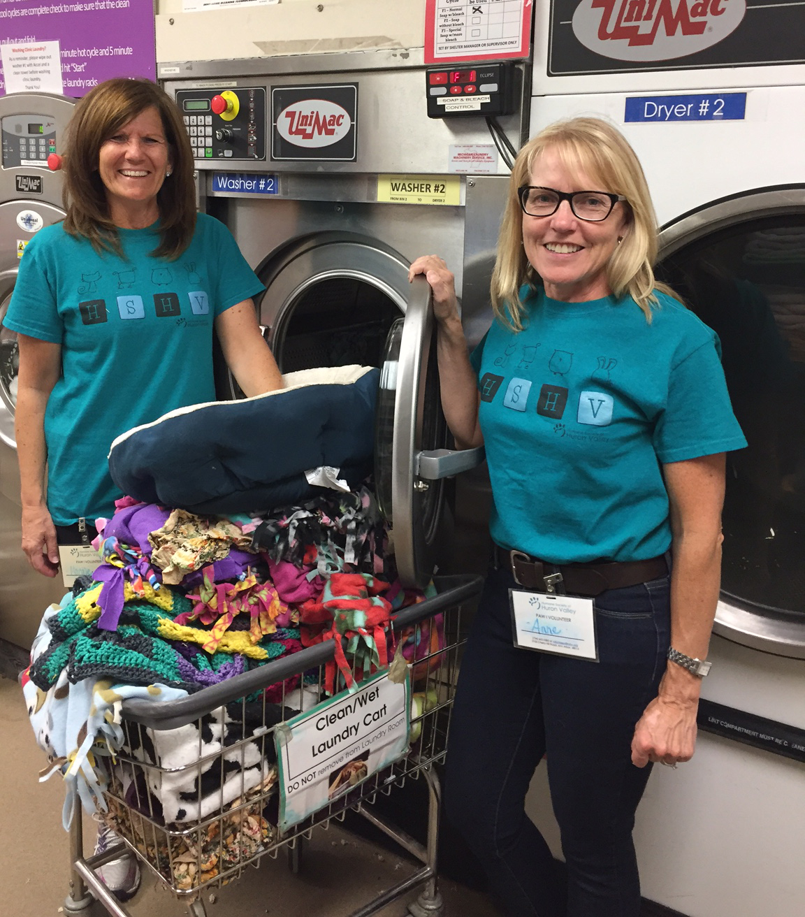 volunteers doing laundry