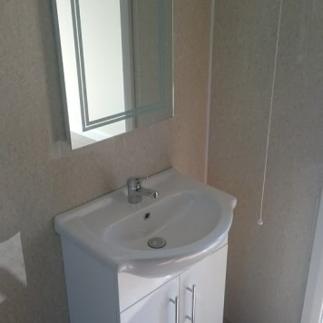 Wash hand basin and mirror.