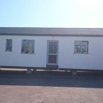 Modular home rear view back door.