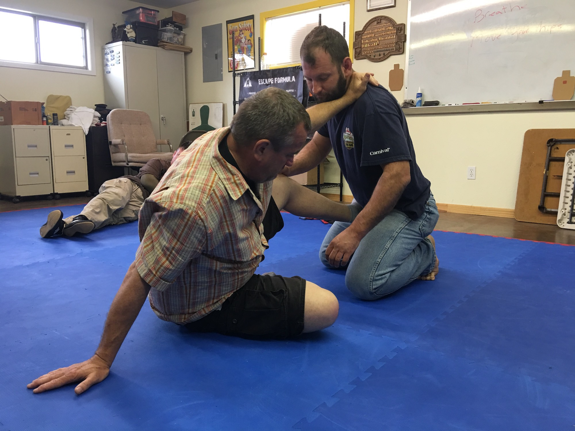 Cecil Burch (left) at KR Training, demonstrating a technique for standing up.