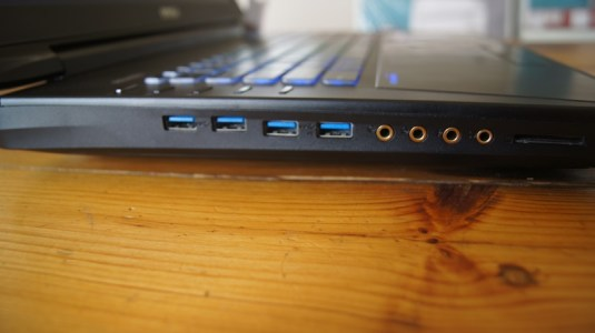 4 USB 3.0 ports, one input, one output, a mic and headphone jack, all on one side of the notebook.