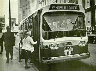 A Safe Bus bus stop on Fourth St., just east of the Reynolds building, near to today's Innovation Quarter. Photo Credit: Forsyth County Public Library