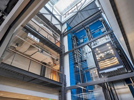 With the construction complete, the Atrium next to the elevator shaft alludes to the once open space of the original structure.