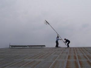 John Gorenflo installs antenna in West DRC