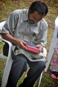 A Shuar man holds the first complete Shuar Bible in Makuma, Ecuador – Aug. 2010. Photo by Chad Irwin.