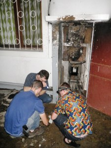 Guys looking at the newly crisped electrical box