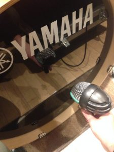 The mic was placed about two inches from the drum, and about three off of the center. There was no hole in the drum to place the mic in front of.