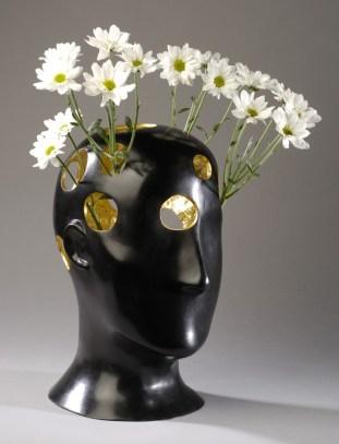 Vase tête du poète décoré