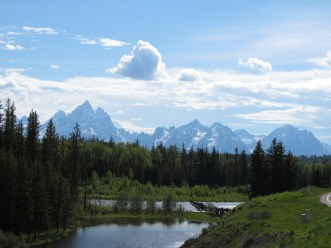 """the Tetons are more than the """"Grand Teton"""". It is the tallest of an impressive range of peaks. but a range of many impressive peaks, This is a view at the northern end of the range, driving into the park from the east, the Dubois side, a much quieter side of the park than the Jackson entrance."""