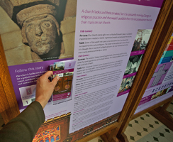Taking a tour leaflet from the church interpretation display