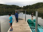 three kids fishing off dock