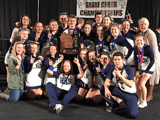 Cheer and stunt team pose with 2016 State Championship trophy.