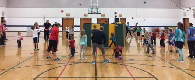 Families participating in an activity at Willow River Elementary's Family Boot Camp.