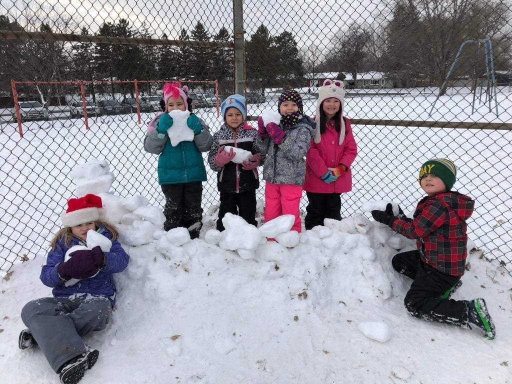 Students making a snow fort at E.P. Rock playground.