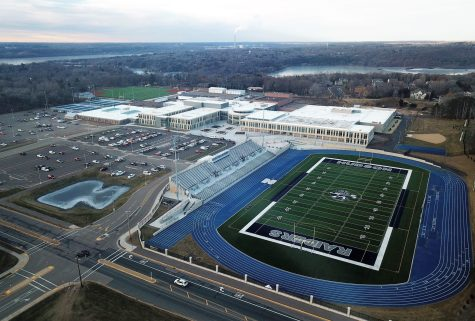 Aerial view of the high school building, stadium and parking lot.