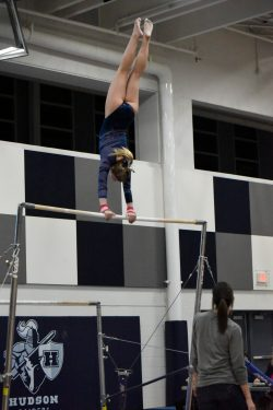 Hudson High School Gymnastics team member on the bar at 1-4-19 meet.