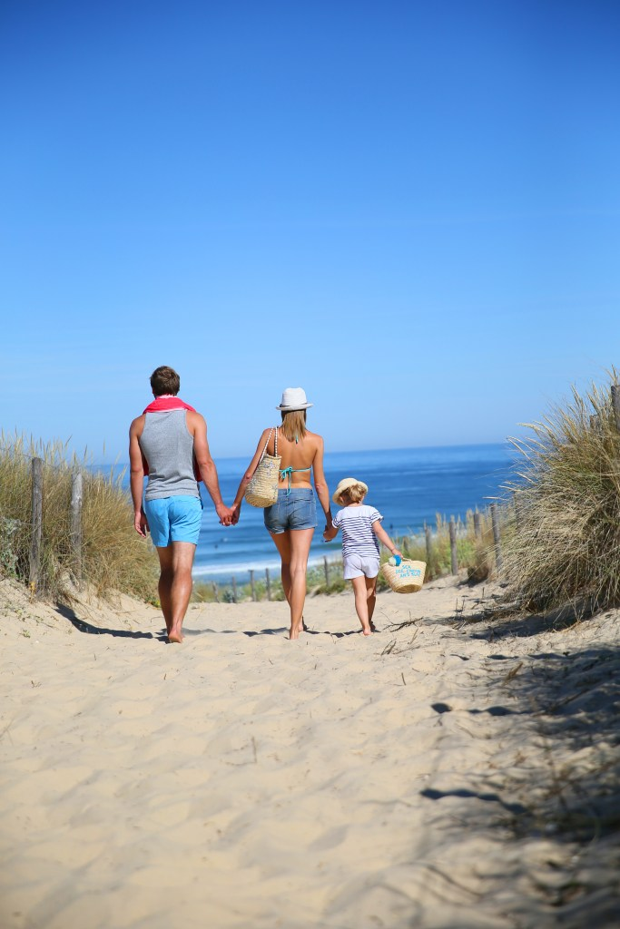 Family on the beach - Plan your family vacation and don't forget travel insurance