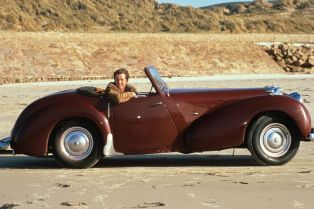 John-Nettles-in-his-Triumph-Roadster-on-set-filming-Bergerac
