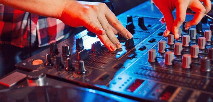 dj hands on dj mixer