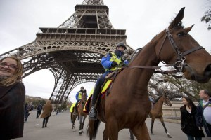 Mounted police pass under the Eiffel Tower in Paris, Monday, Nov. 16, 2015. France is urging its European partners to move swiftly to boost intelligence sharing, fight arms trafficking and terror financing, and strengthen border security in the wake of the Paris attacks. Photo: AP