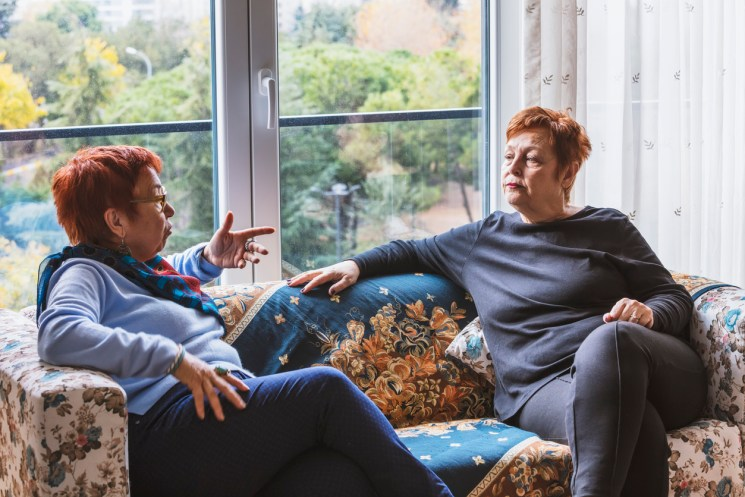Two women discussing funeral plans