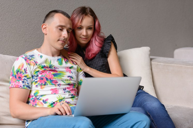 Couple watching online funeral