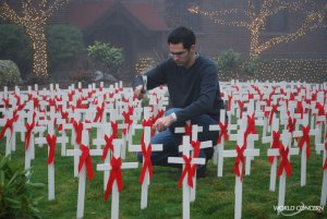 World Concern staff member Derek Sciba helps install 1,000 crosses for World AIDS Day 2008.