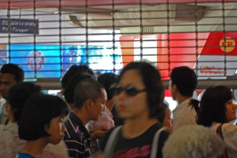 """Security gates shut out """"red shirt"""" protesters and other potential riders at Bangkok's Siam rail station."""