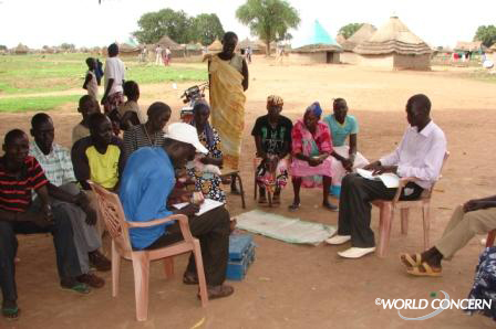 Villagers in Sudan meet to give loans to the next business owner, and check on the progress of the savings.