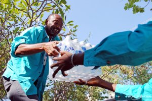 Christon Domond distributes water after earthquake.