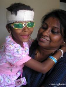 Selina Prem Kumar with an injured child.