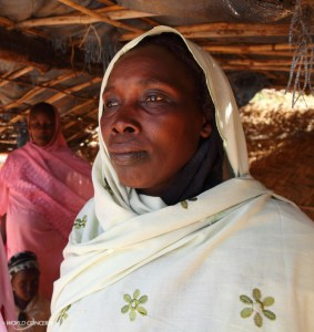 Ache stands inside a hut in Chad.