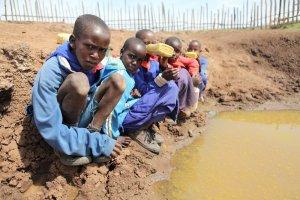 Kenyan boys at pond.