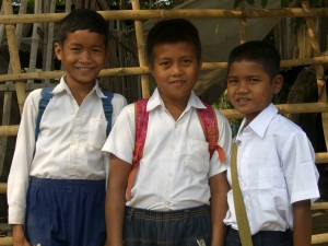 Oury, Navin and Pandey in their school uniforms.