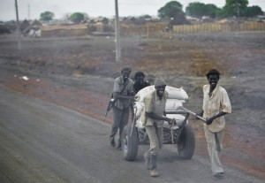 Men looting food in Sudan.
